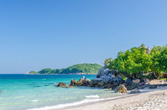 Rock sea and blue sky at Ta-Yai beach Stock Image