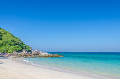 Rock sea and blue sky at Ta-Yai beach Royalty Free Stock Image