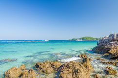 Rock sea and blue sky at Ta-Yai beach Royalty Free Stock Photos