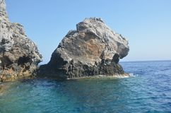 Rock in the sea in the form of a lion`s head stock photography