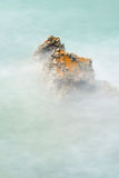 Rock and sea with long exposure Royalty Free Stock Photography