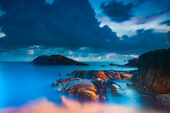 Rock in the sea with long exposure shooting Royalty Free Stock Photography