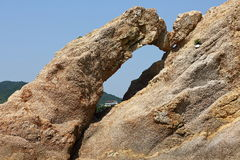 The rock by the sea. The majestic rock by the sea Royalty Free Stock Image