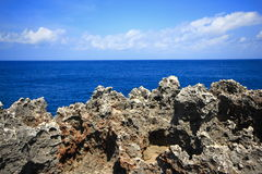 Rock sea ocean  island blue sky Royalty Free Stock Photography
