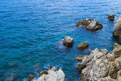 Rock in the sea. The rocky coastline. Rock in the sea Royalty Free Stock Photography