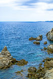 Rock in the sea. The rocky coastline. Rock in the sea Royalty Free Stock Image