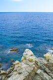 Rock in the sea. The rocky coastline. Rock in the sea Stock Photos