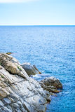 Rock in the sea. The rocky coastline. Rock in the sea Royalty Free Stock Images
