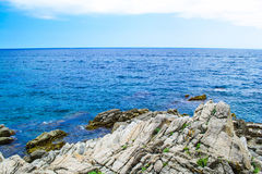 Rock in the sea. The rocky coastline. Rock in the sea. Mountains Stock Photos