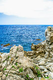 Rock in the sea. The rocky coastline. Rock in the sea. Mountains Royalty Free Stock Image