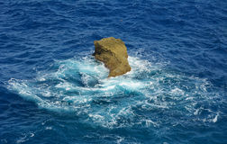 Rock in the sea (Saipan) Stock Images