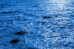 Rock in the sea.Sea waves crash on a rock in the sea.Rock on the Royalty Free Stock Photos