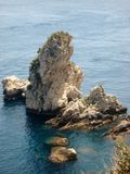 Rock on the sea. A rock at the seaside Sicilian Royalty Free Stock Photography