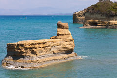 Rock in the sea in Sidari on Corfu Stock Images