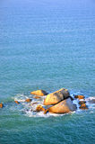 Rock and sea water in sunrise lighting Royalty Free Stock Photos
