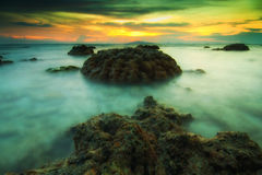 The rock. A rock in the Sea water at sunset in Thailand Stock Photos