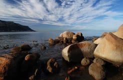 Rock Seascape. Boulders in sea at Fish Hoek beach along False bay coastline Stock Photos