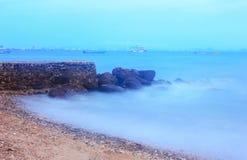 Rock seashore. Waves soft hitting rocky coast of island Stock Images