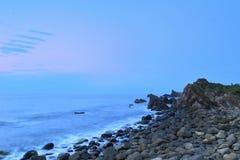 Rock seaside dawn Stock Photo