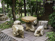 Rock seat in garden Stock Photos