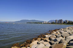 A rock seawall protects a park Stock Photography