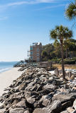 Rock Seawall Toward Piers and Beach Houses Stock Photography