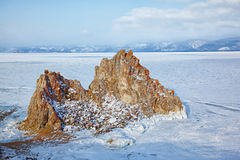 Rock Shamanka on cape Burkhan on Olkhon island in Siberian lake Royalty Free Stock Images