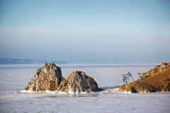 Rock Shamanka on Olkhon island in lake Baikal in winter Royalty Free Stock Photo