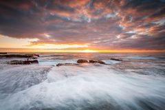 Rock shelf flows and waterfalls Maroubra royalty free stock image