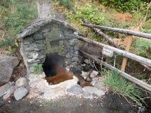 Rock shelter over natural hot spring Stock Images