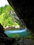 Rock shelter at waterfall basin in alpine geopark Stock Photos