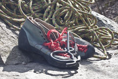 Rock shoes. Climbing shoes on stone and rope Stock Photo