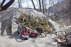 Rock shoes. Climbing shoes on stone and rope Stock Image