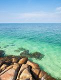 Rock shore of island and blue sea Royalty Free Stock Images