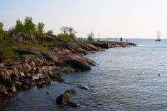 Rock shoreline. Rocky shore of the Baltic Sea. Scandinavia Royalty Free Stock Photography