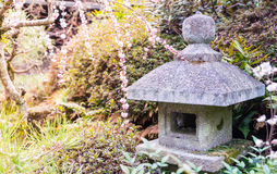 Rock Shrine in Plum garden Royalty Free Stock Image