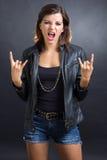 Rock sign. Brunette girl showing rock sign Stock Photos