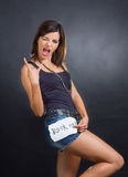 ROCK sign. Brunette rock girl showing a ROCK sign Stock Images