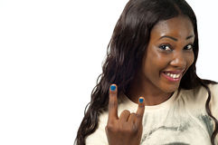 Heavy metal hand gesture. Smiling woman with characteristic heavy metal hand gesture on white background stock image