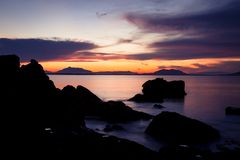 Rock silhouettes and vivid sunset Royalty Free Stock Photos
