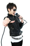 Rock singer. Asian rock singer in performance, isolated on white, focus on fingers Royalty Free Stock Photo