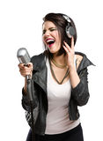 Rock singer with mic and earphones Royalty Free Stock Photography