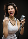 Rock singer with microphone Royalty Free Stock Photo