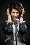 Rock singer with microphone and headphones Stock Image