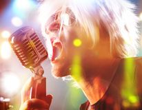 Rock singer with retro microphone Stock Photography