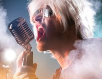 Rock singer with retro microphone Stock Images