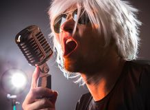 Rock singer with retro microphone Royalty Free Stock Images