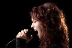 Rock Singer Screaming. Rock Woman Singer Screaming in the Microphone Stock Photos