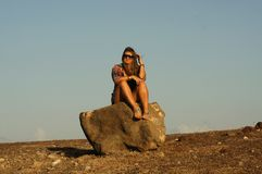 Rock, Sky, Sitting, Girl royalty free stock images