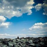 Rock slide against blue sky Royalty Free Stock Photos